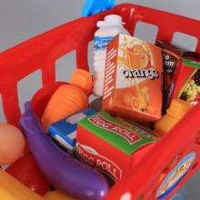 Касов апарат и количка за пазаруване с продукти